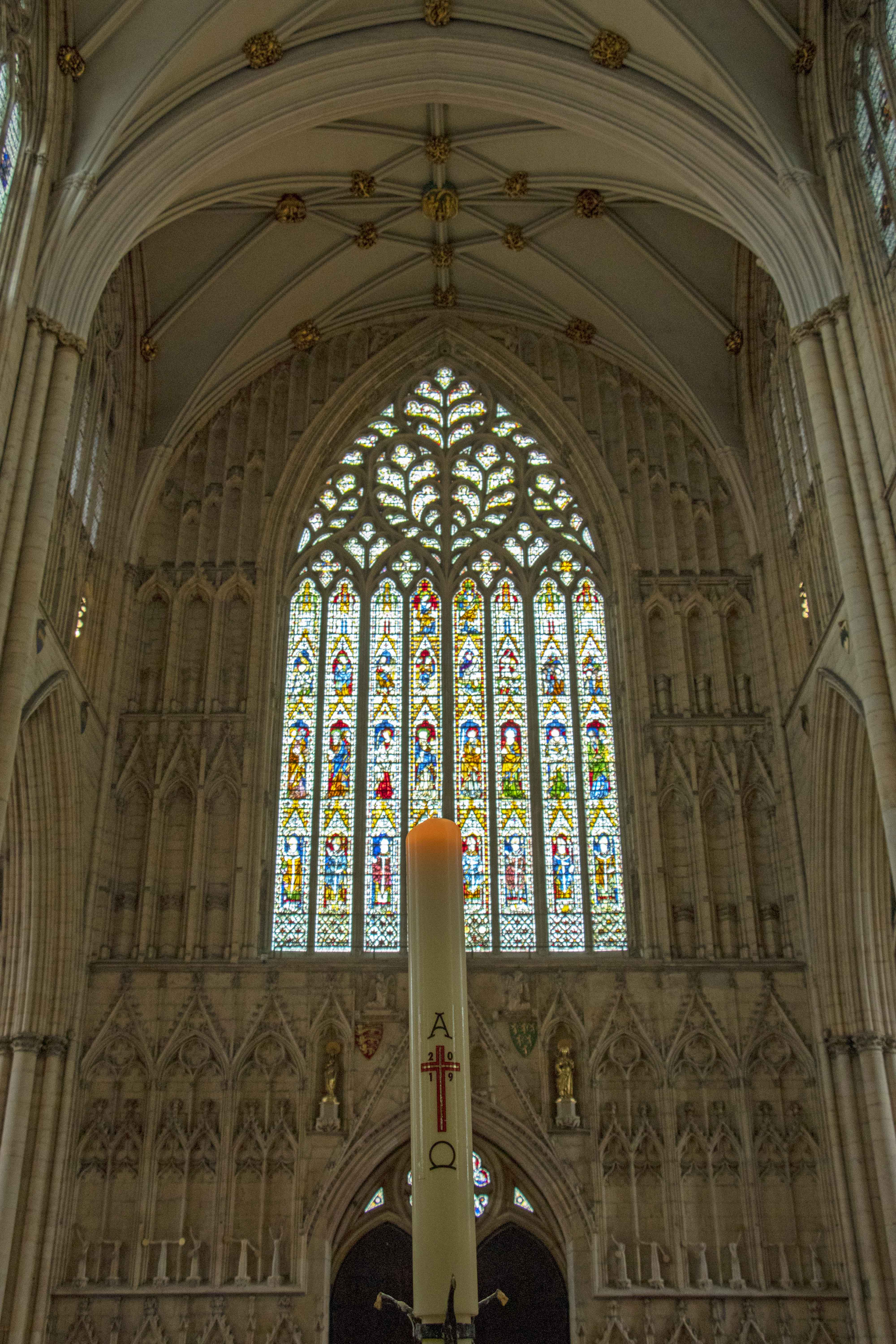 York Minster stained glass window and candle