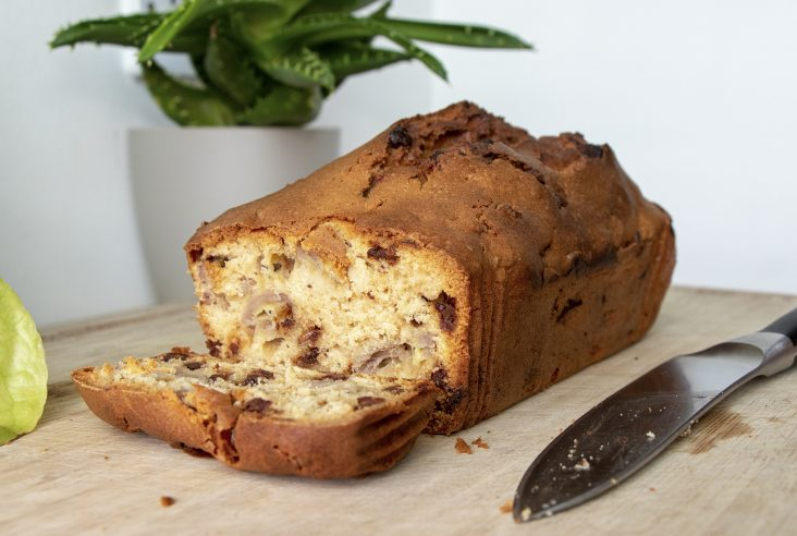Sliced easy banana bread with chocolate chips on a chopping board