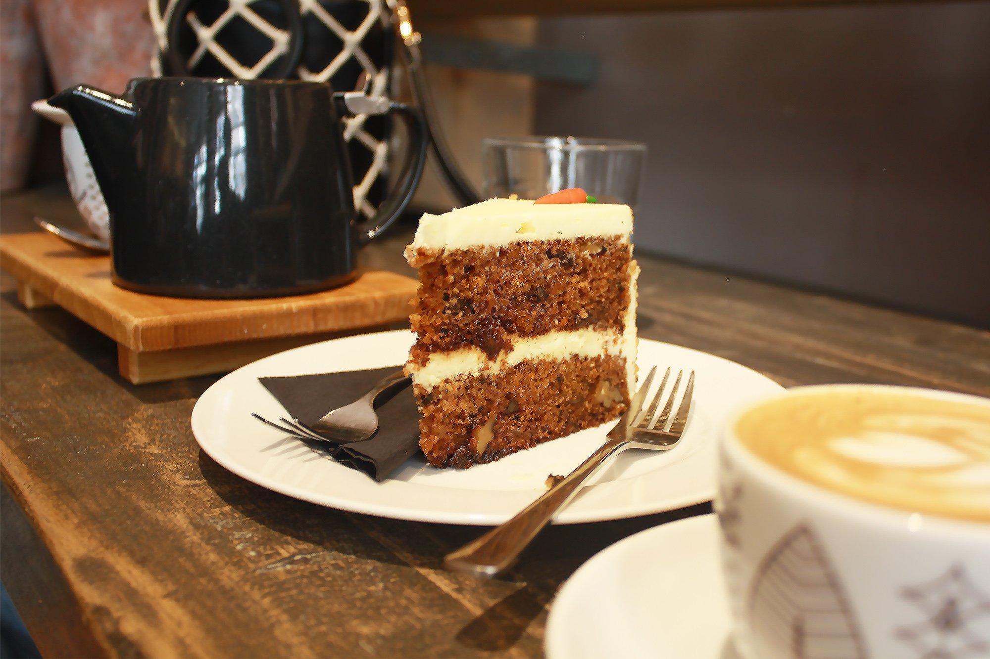 Carrot cake, tea and latte at La Boheme Cafe