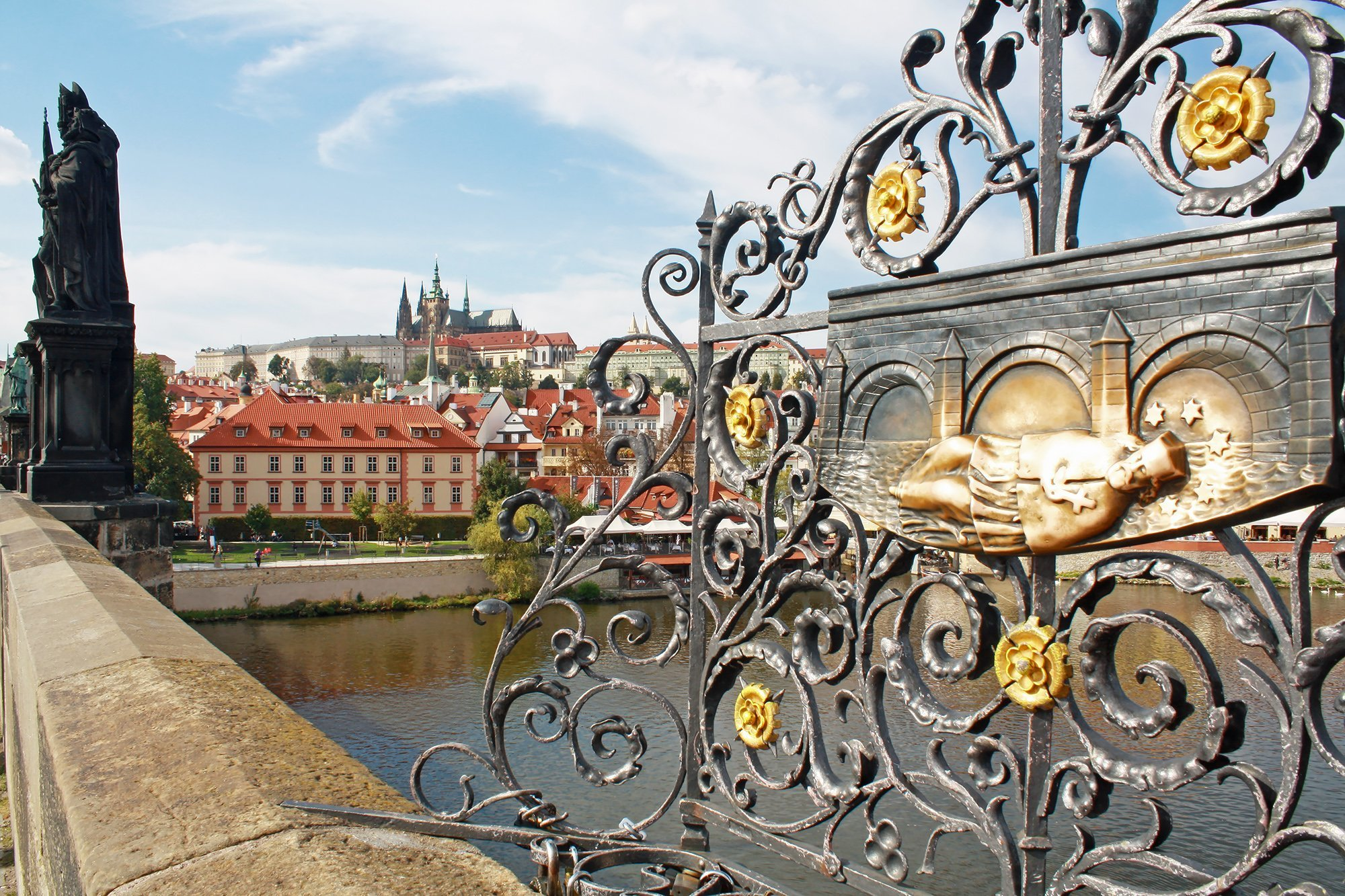 Prague Castle from Charles Bridge and statues