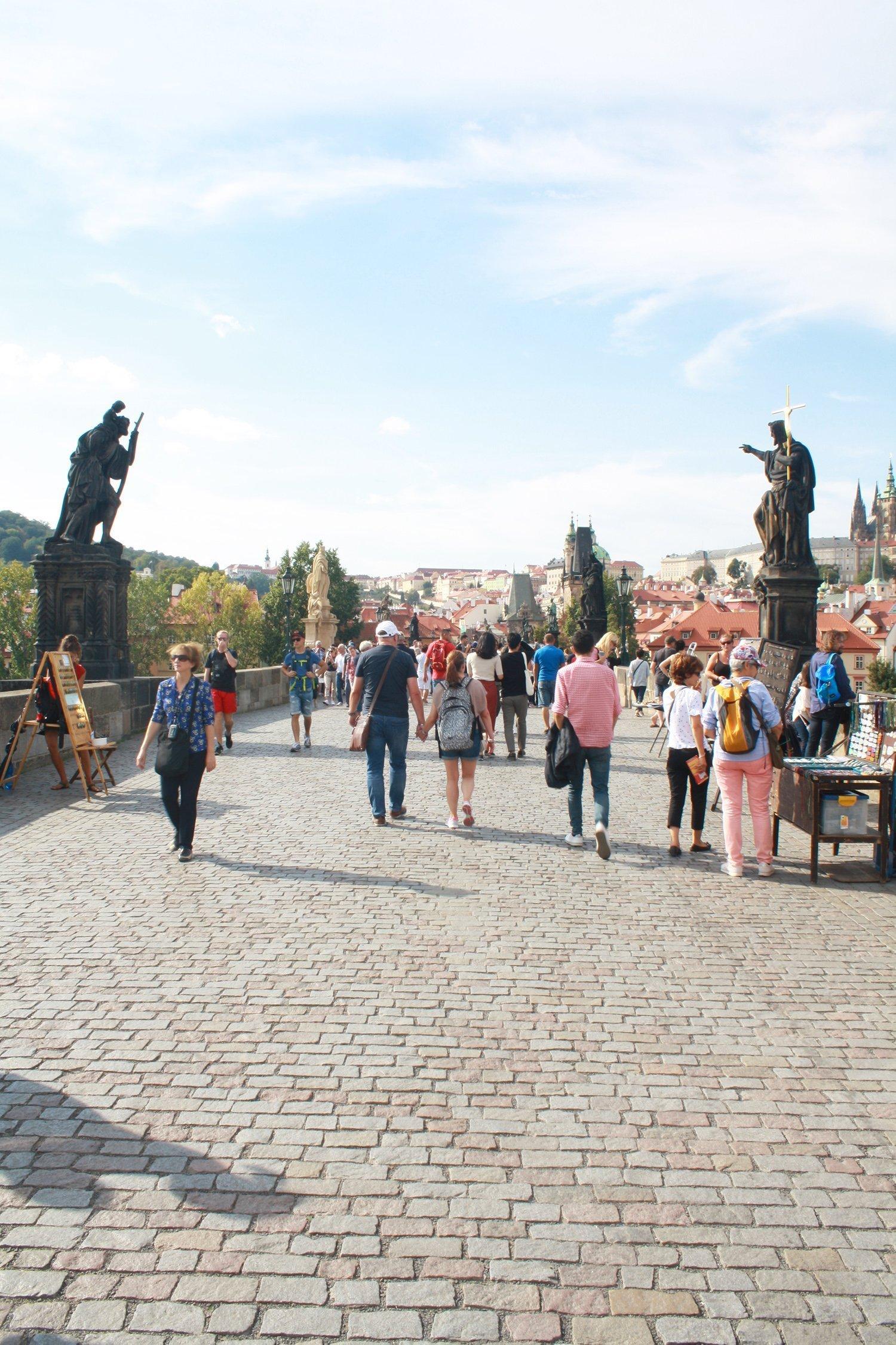 Walking over Charles Bridge, Prague