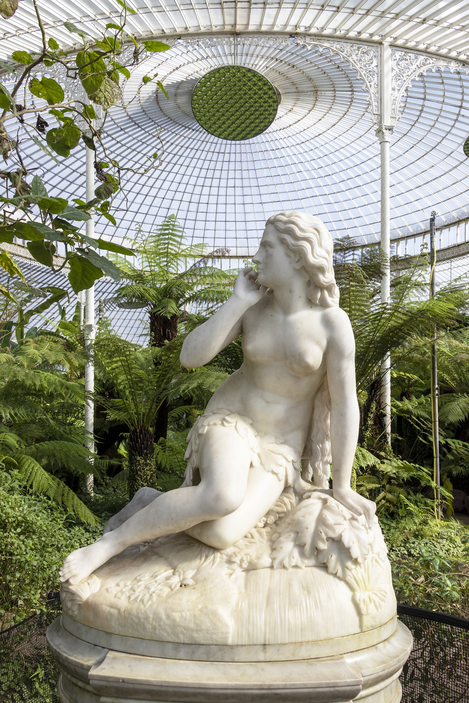 Marble statue of Eve in Kibble Palace, Glasgow Botanic Gardens