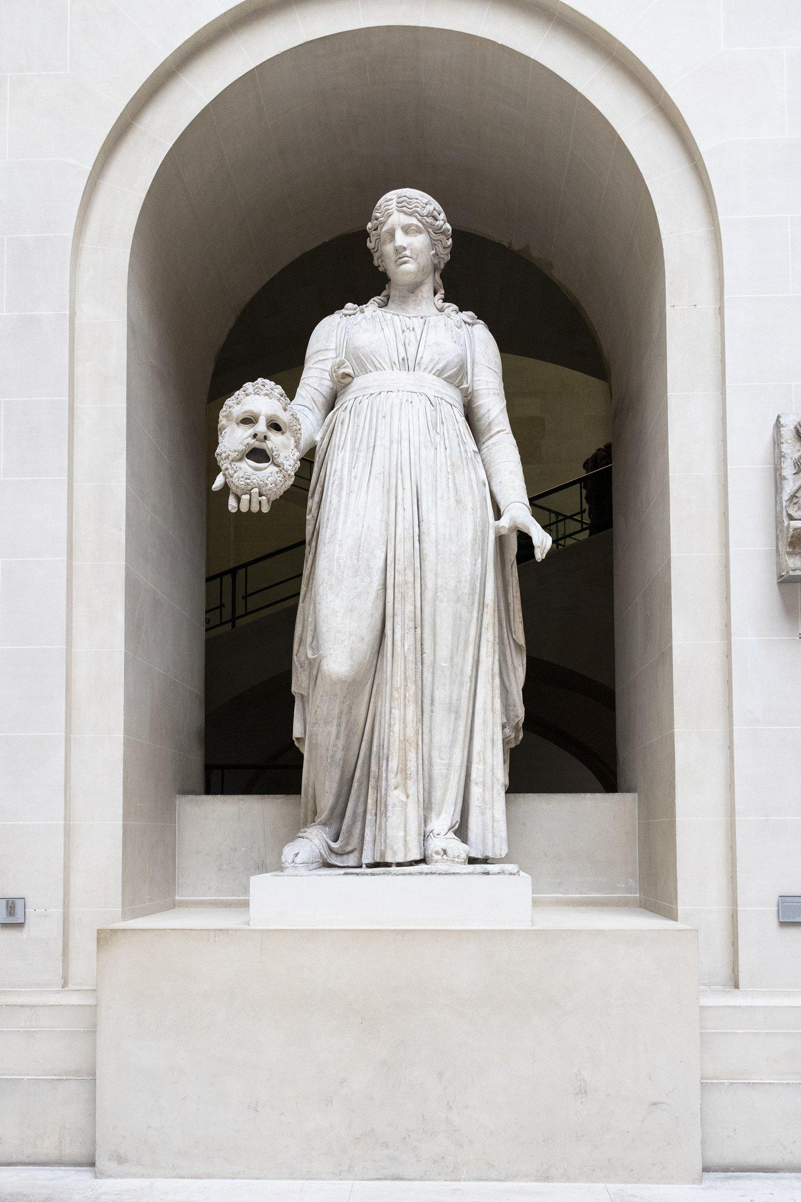 Roman statue of Melpomene holding mask - Louvre museum, Paris