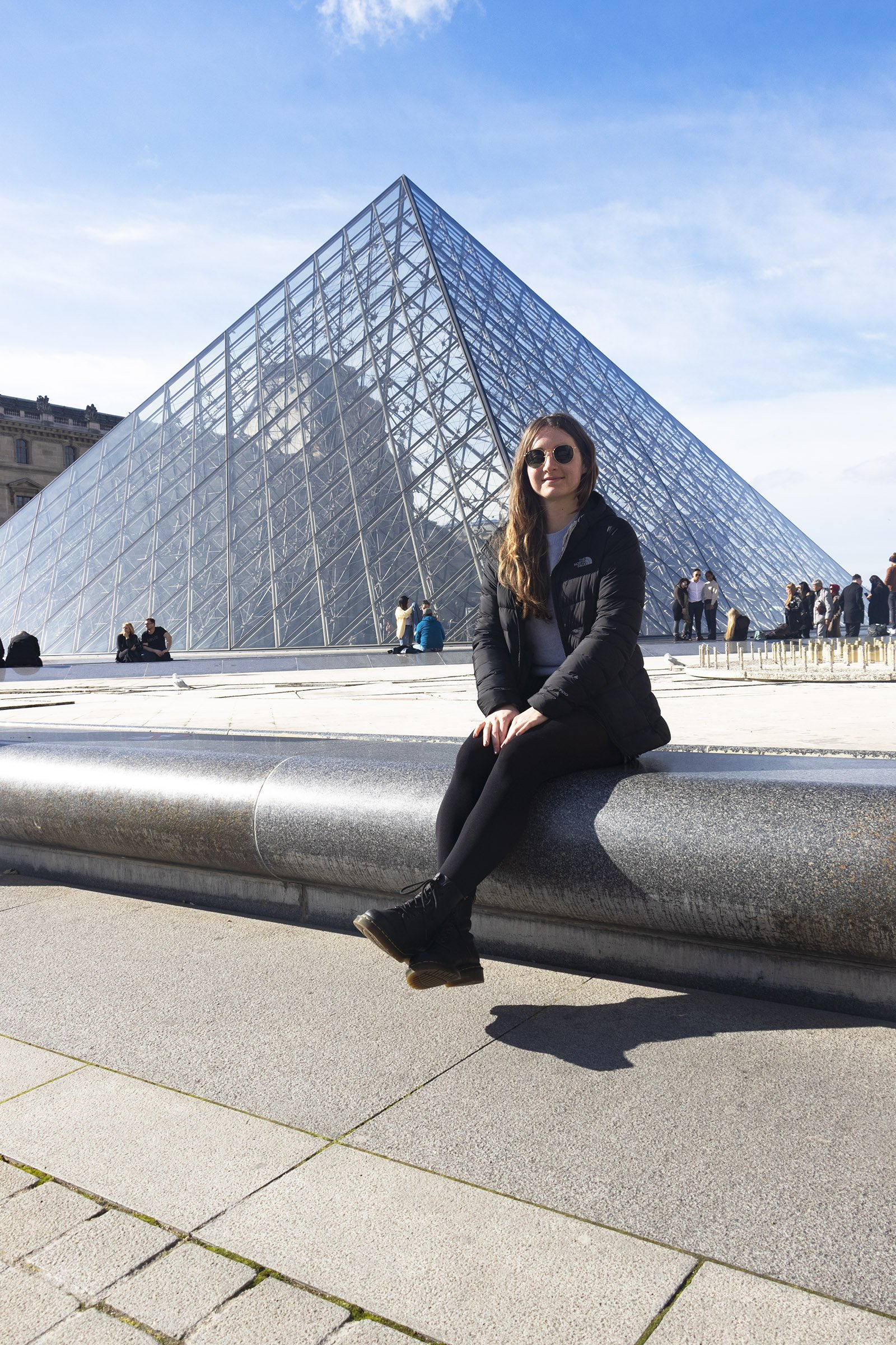 Sitting in front of Louvre pyramid